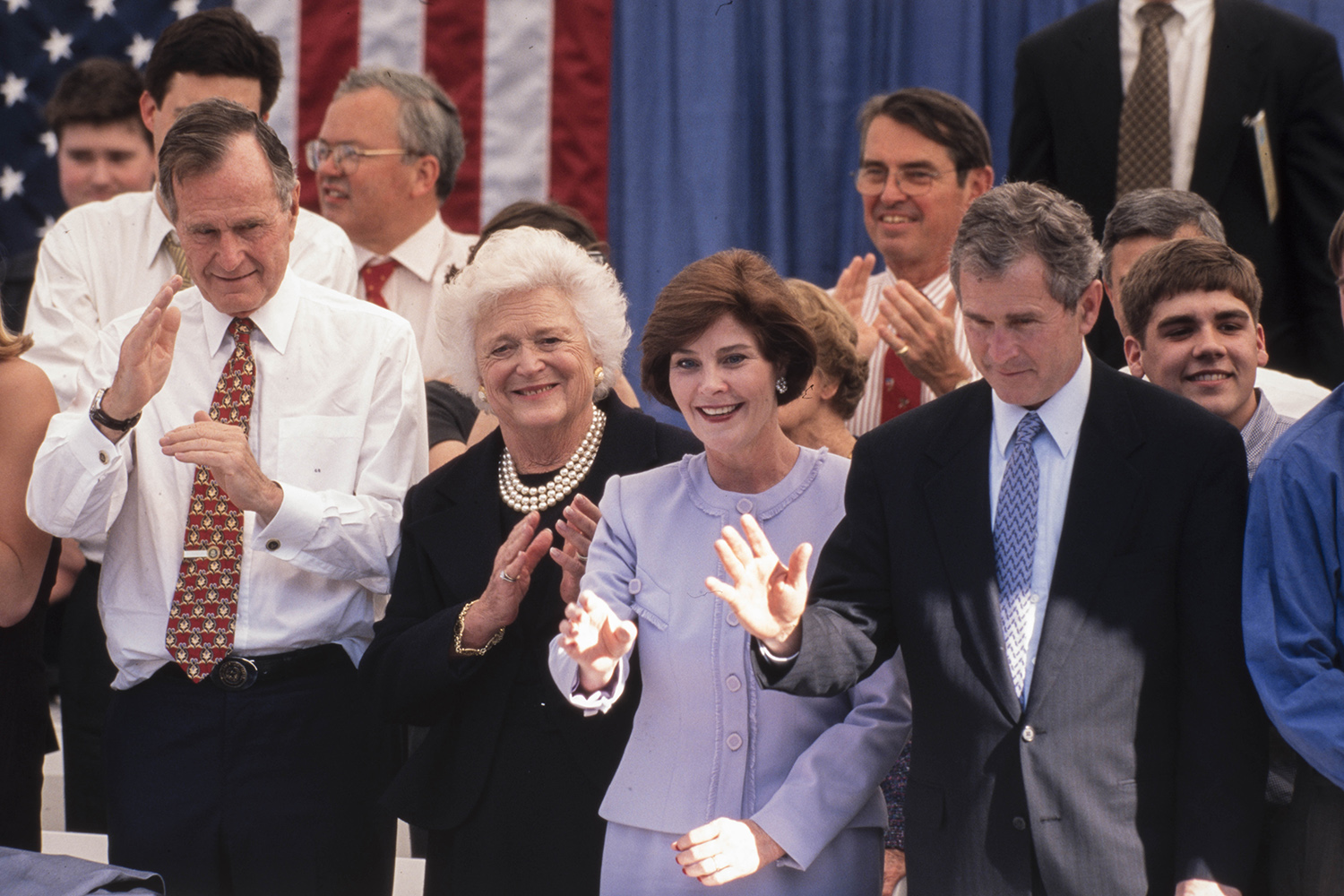 Left to right: Former President George H.W. Bush, his wife, former First Lady Barbara Bush, Laura Bush and her husband George W. Bush, who was being inaugurated for his second term as governor, in Austin on Jan. 19, 1999.