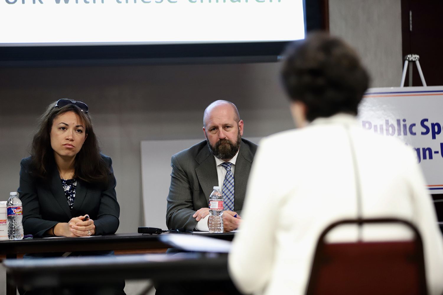 Texas Education officials Penny Schwinn and Justin Porter listen to testimony at a hearing on special education in Richardson on April 16, 2018.