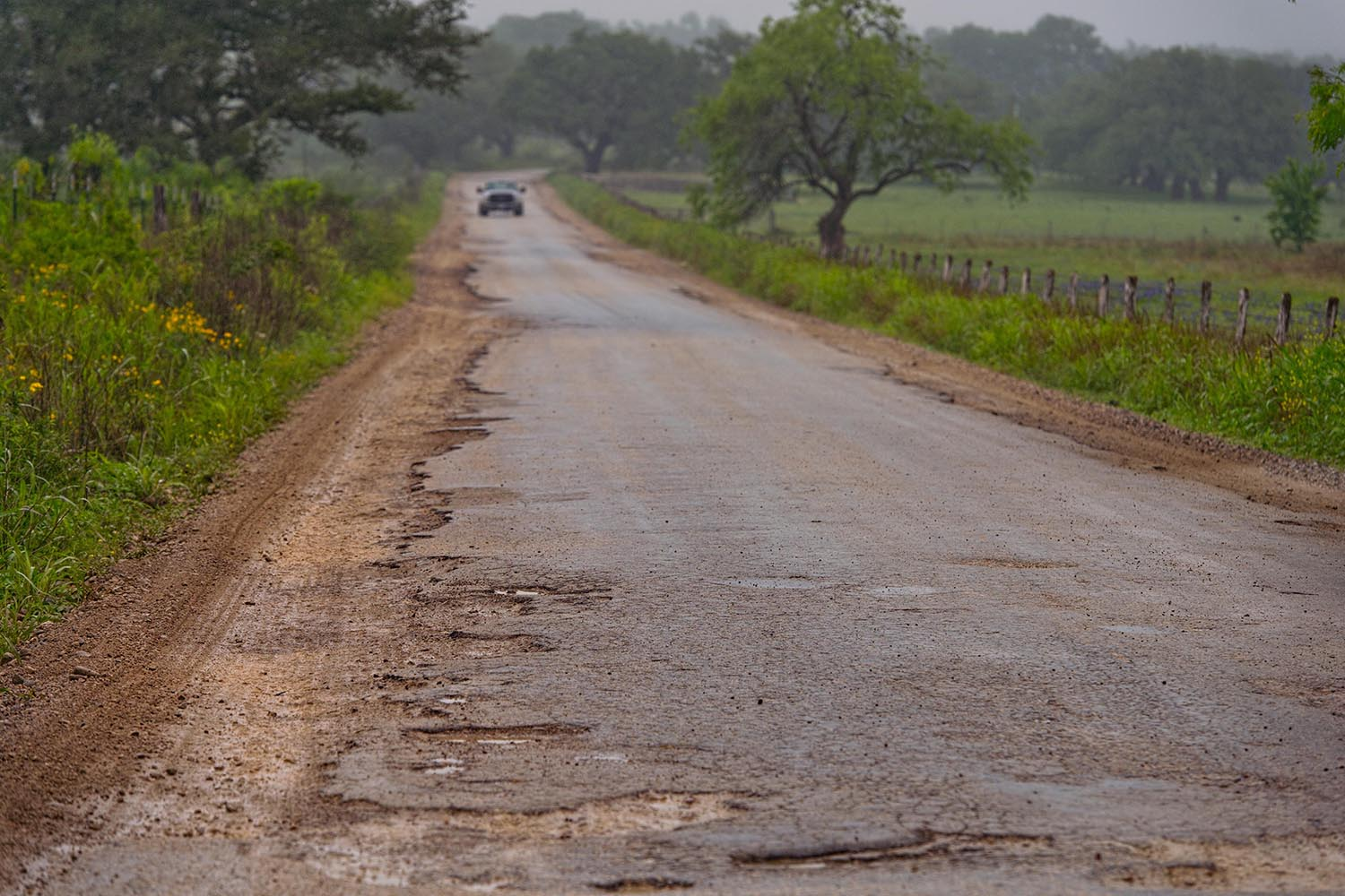 Badly damaged road on FM 2067/ Cheapside Rd. near Cheapside on April 10, 2018.