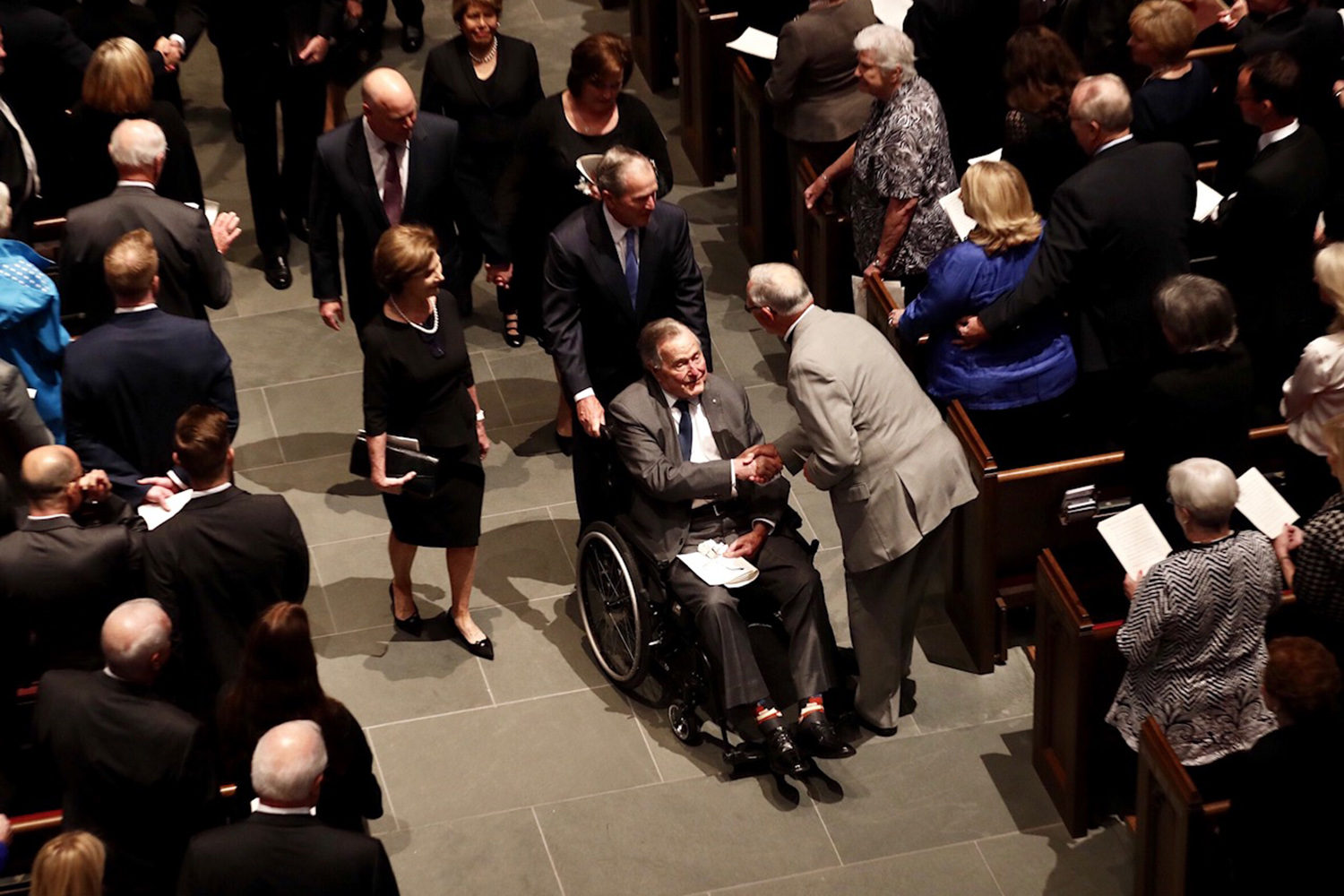 Former President George H.W. Bush accepts condolences as he leaves St. Martin's Episcopal Church after the funeral service for his wife Barbara, in Houston on April 21, 2018. The former first lady will be interred in College Station.