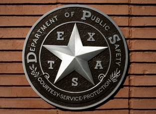 A Texas Department of Public Safety official seal.