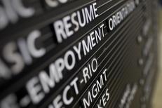 An announcement board in an Austin unemployment office.