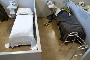 An inmate sleeps in his cubicle in the geriatric unit of the Estelle Prison in Huntsville.