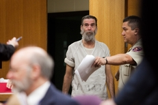 Mark Norwood being led into court for the first time on Jan. 18th 2011. He is charged with the 1986 murder of Christine Morton.