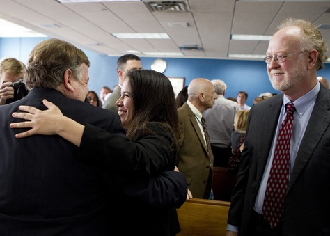 Attorneys representing Texas school districts congratulated each other after a judge ruled on Feb. 4, 2013, that the state's school finance system was unconstitutional.