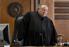 State district Judge John Dietz issuing a ruling in the school finance trial on Feb. 4, 2013.