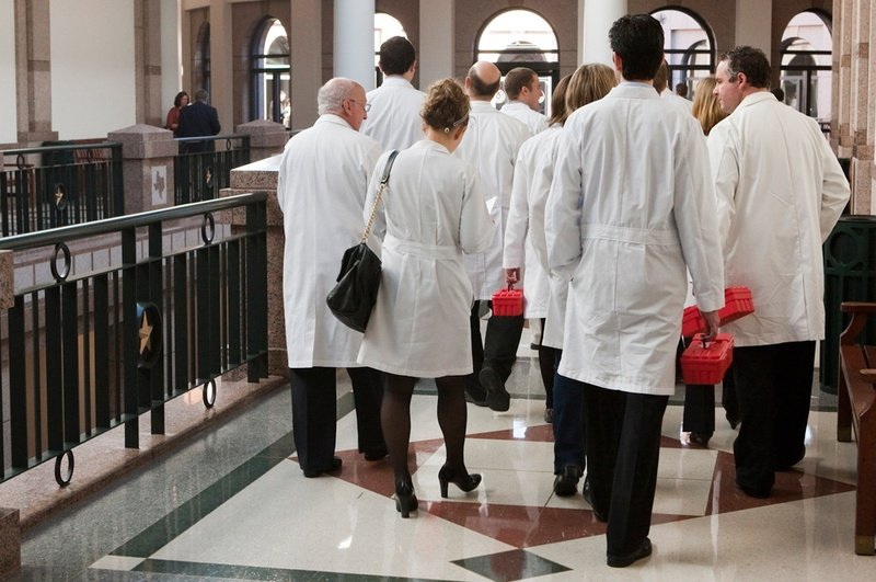 A group of medical doctors in the hallway of the Capitol extension on Feb. 8, 2013.