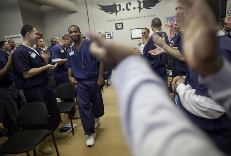 "Brandon Biko Reese, who will soon be released after serving a five-year sentence, is enthusiastically welcomed to the front of the room to give a farewell speech. In an effort to ""de-gangsterize"" inmates, administrators encourage them to dance and cheer for their peers whenever possible."