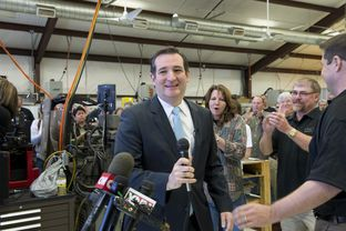U.S. Sen Ted Cruz is welcomed at LaRue Tactical, a gun manufacturer in Leander, by founders Ellen LaRue, center, and Mark LaRue, right, on Feb. 19, 2013.
