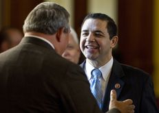 U.S. Rep. Henry Cuellar (D-Laredo) speaks with state Rep. Doug Miller R-New Braunfels, during a visit to the Texas Capitol on Feb. 19, 2013.