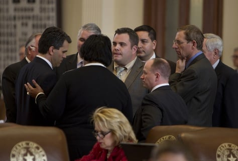 Group of House members gather around the back mic before vote on supplemental bill  HB 10 which ultimately cleared the House on February 21st, 2013