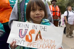 Six year old girl, holds up sign during immigration reform rally at the Texas Capitol on February 22nd, 2013
