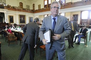 Jeb Bush leaves the Senate Education Committee after making a presentation on Florida education on Feb. 27, 2013.