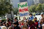 Demonstrators participate in a mental health rally at the Texas Capitol, organized by the National Alliance on Mental Illness, on Feb. 28, 2013.