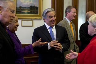 UT System Chancellor Francisco Cigarroa shakes hands with visitors at a Senate reception on Mar. 5, 2013.