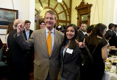 """UT President Bill Powers does the """"Hook-em 'Horns"""" with student Lariza Uribe at the Texas Capitol on Mar. 5, 2013."""