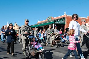 Service members and their families from Goodfellow Air Force Base, Texas, participate in the Veterans Day parade in San Angelo, Texas, Nov. 6, 2010.