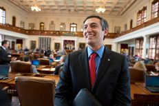 Freshman Giovanni Capriglione, R-Southlake, talks to colleagues in the House chamber on March 4, 2013.  Capriglione received criticism in committee for proposing a bill that would increase transparency in member's business dealings.