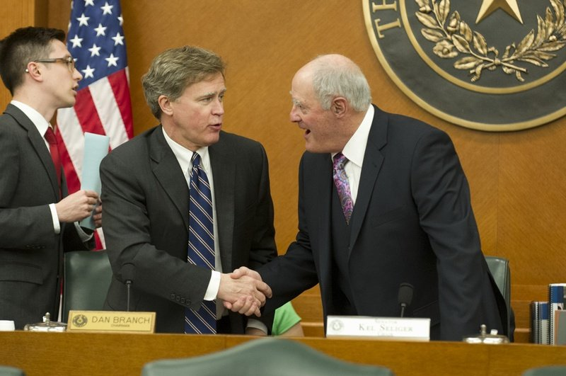 State Rep. Dan Branch, R-Dallas,l, and State Sen. Kel Seliger, R-Amarillo, shake hands upon convening the Joint Committee on Higher Education Oversight on March 19, 2013.