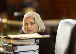 Sen. Judith Zaffirini D-Laredo, peeks over stack of binders at her desk during discussion of budget bill SB1 on March 20th, 2013