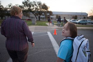 Stacy Ford taking her daughter, Aurora, who is 11 years old and has Down Syndrome, to school on Tuesday, March 19, 2013.