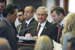 Bill sponsor State Rep. Jimmie Don Aycock, R-Killeen, is surrounded by members at the front mike while debate continues on HB 5 on March 26, 2013.