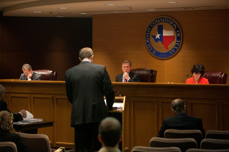 The Texas Railroad Commission, comprised of Chairman Barry T. Smitherman (center), and commissioners David Porter (left) and Christi Craddick (right) hold an open meeting in Austin, Texas on Jan. 15, 2013.