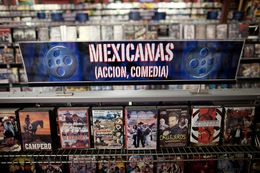 Low-budget movies about narcos, or Mexican drug dealers, are displayed on a shelf in Video Mexico, a video rental store in Austin.