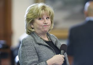 Sen. Jane Nelson, R-Flower Mound, grimaces as she lays out her CPRIT reform bill in the Senate on April 3, 2013.