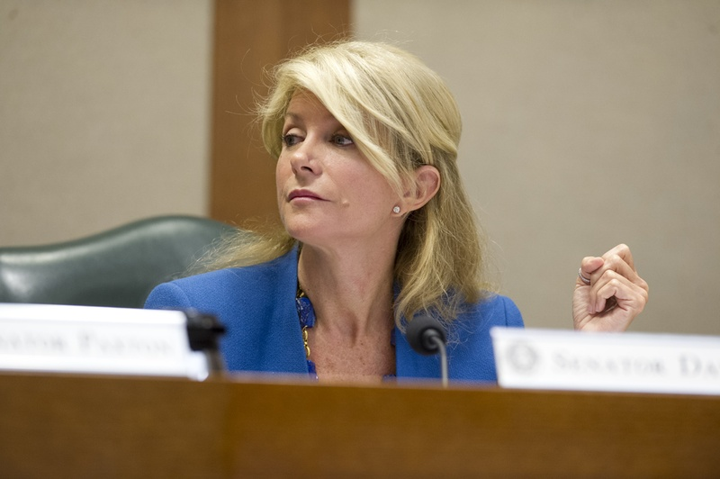 Sen. Wendy Davis, D-Fort Worth, listens after questioning Chairman Dan Patrick, R-Houston, on SB 23 in Senate Education Committee April 9, 2013.