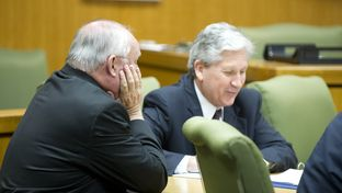 Judge Ken Anderson, l, sits at the defense table as the court of inquiry begins in Georgetown on April 19, 2013.