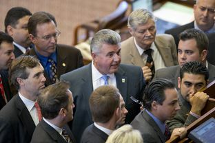 State Rep. Allen Fletcher, R-Cypress, stands among House members during the consideration of a point of order on a campus carry bill on May 4, 2013.