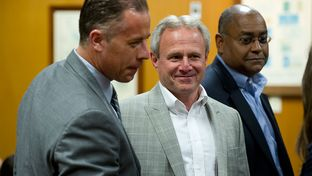 Michael Morton, at the Williamson County Courthouse on April 19, 2013, stands with state Sen. Rodney Ellis, D-Houston, an author of the Senate Bill 1611, and Ellis' chief of staff, Brandon Dudley, who also worked on the legislation.