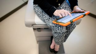Village Health Partners in Plano, Texas uses an iPad to screen for mood disorders.