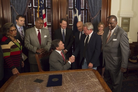 Gov. Rick Perry ceremonially signs Senate Bill 1611, known as the Michael Morton Act, which requires prosecutors to disclose evidence in criminal cases. Morton served nearly 25 years in prison for his wife's murder before he was exonerated in 2011.