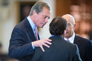 Lt. Gov. David Dewhurst speaks to state Sen. Kevin Eltife, R-Tyler, as state Sen. John Whitmire, D-Houston, watches on March 25, 2013.