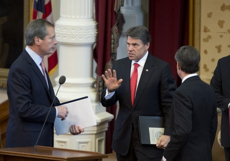 Gov. Rick Perry, c, talks with Lt. Gov. David Dewhurst and House Speaker Joe Straus after a military memorial ceremony in the Texas House chamber on May 25, 2013.