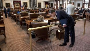 House Speaker Joe Straus speaks with State Rep. Stephanie Klick, R-Fort Worth, as the chamber awaits word of a special session mid-afternoon on May 27, 2013.