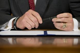 Gov. Rick Perry prepares to sign a series of education reform bills in the Governor's Reception Room on June 10, 2013.