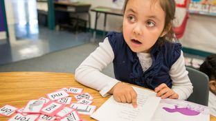 An early reader looks to teacher, Josefina Pineda, in her Pre-K at the Dallas Independent School District elementary school Cesar Chavez Learning Center in Dallas, Texas.