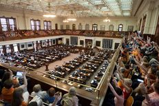 """A packed Texas House gallery, filled mostly with the pro-choice group """"Stand with Texas Women,"""" cheer during a speech by Rep. Jessica Farrar D-Houston on June 23rd, 2013"""