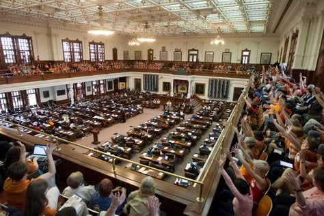 "A packed Texas House gallery, filled mostly with the pro-choice group ""Stand with Texas Women,"" cheer during a speech by Rep. Jessica Farrar D-Houston on June 23rd, 2013"