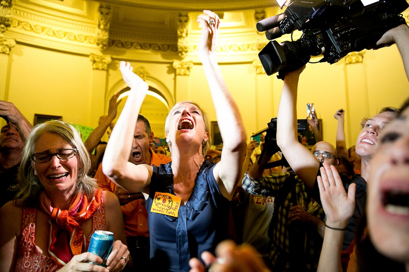 Cecile Richards, president of the Planned Parenthood Federation of America, cheering with activists to disrupt the last minutes of the vote on Senate Bill 5.