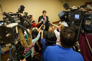 Governor Perry answers press questions after his speech at the National Rights for Life convention in Dallas.