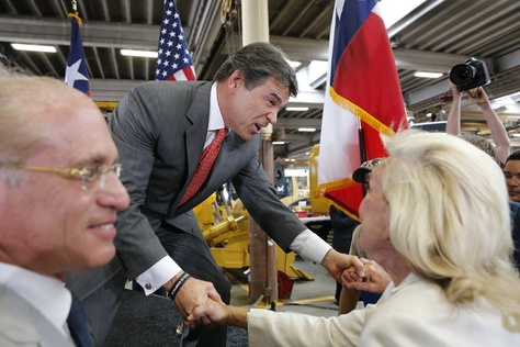 Gov. Rick Perry shakes hands with well-wishers after his announcement that he will not seek reelection in 2014.