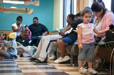 Patients wait to be seen at the People's Community Clinic in Austin, on Nov. 8, 2010.