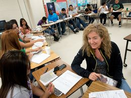 Veteran English teacher Sara Brenan works with students at Anderson High School's summer program in the Austin Independent School District.