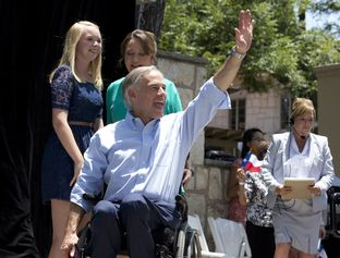 Attorney General Greg Abbott enters LaVillita with his wife Cecelia and daughter Audrey as he announced for Texas governor on July 14, 2013.