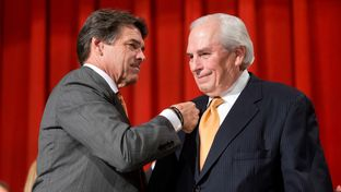 Gov. Rick Perry and Gene Powell at the signing of a merger bill between UT-Pan American and UT-Brownsville on July 16, 2013.