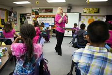 Bayless Elementary teacher Holly Guillmen identifies and explains the use of the contents of the Waterwise home water conservation kit provided to students by the High Plains Underground Water District in Lubbock, Texas, Oct. 17, 2012.